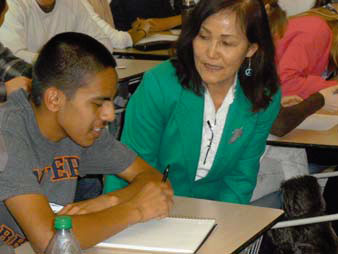 Fort Collins High School student, Erik Garcia Arellano, and visiting author, Maija Rhee Devine.